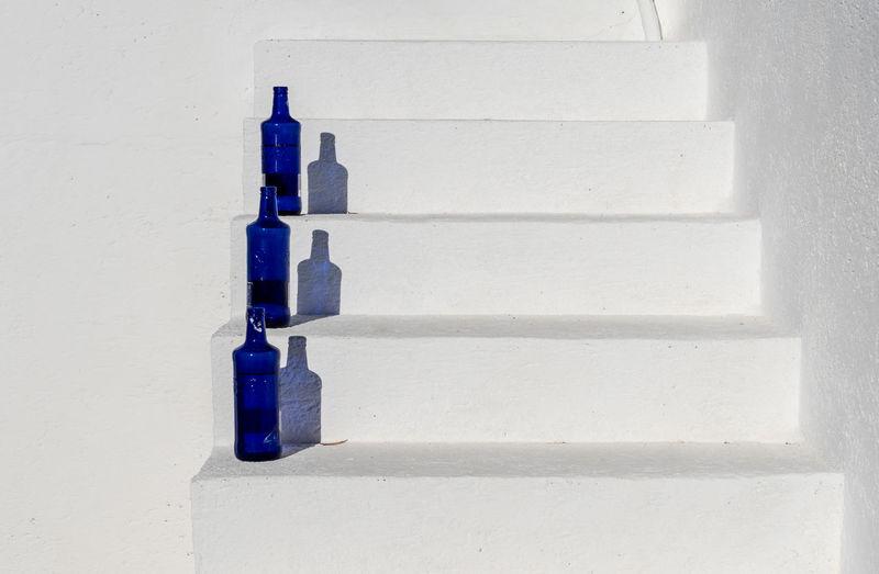 Close-up of bottles on steps