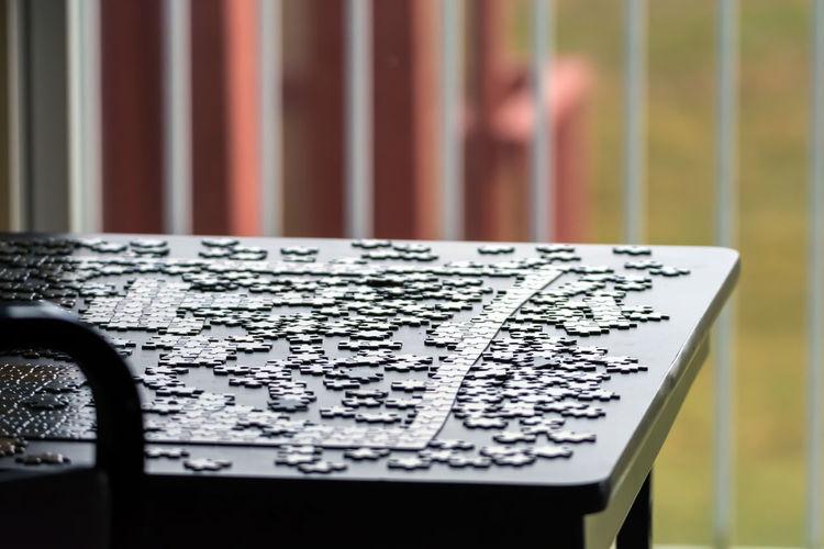 Jigsaw Pieces On Table