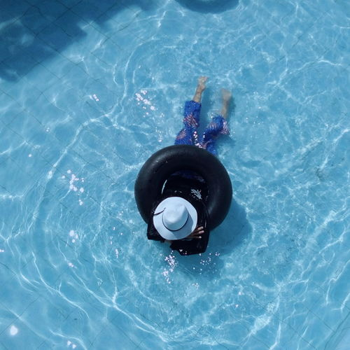 High angle view of floating on swimming pool