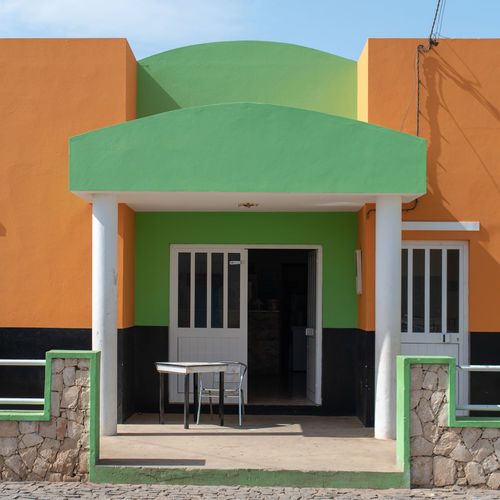 Hoffi99 Day Architecture Built Structure Building Exterior Green Color Seat No People Building Chair Absence House Entrance Outdoors Door Wall - Building Feature Orange Color Residential District Window Nature Empty