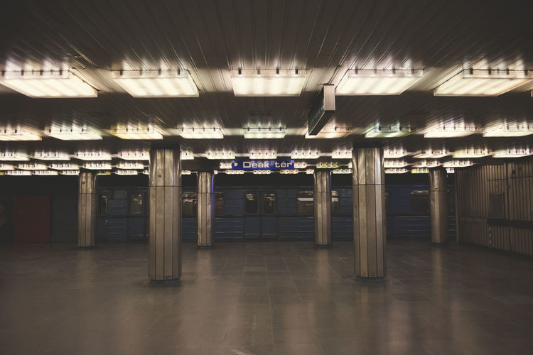 Dark and lonely subway station in budapest, without people Absence Architectural Column Architecture Building Built Structure Ceiling Direction Empty Entrance Flooring Illuminated Indoors  Lighting Equipment No People Public Transportation The Way Forward Transportation