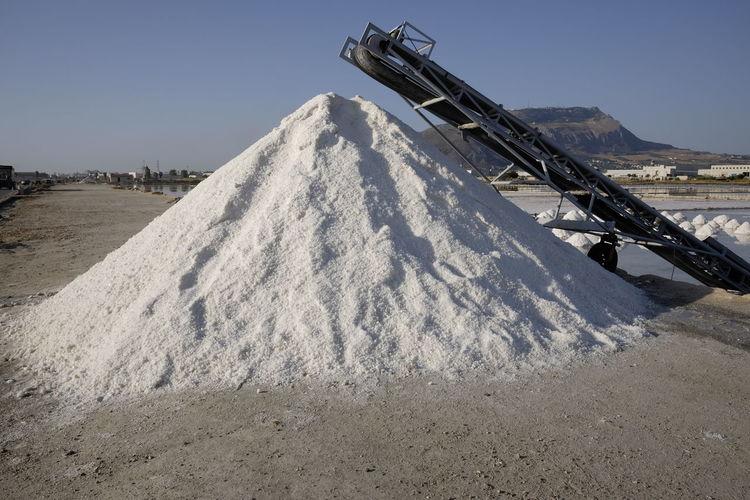 Heap of salt at mine against sky