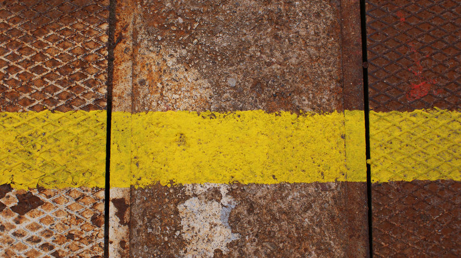 Single Yellow Line On Rusty Metal
