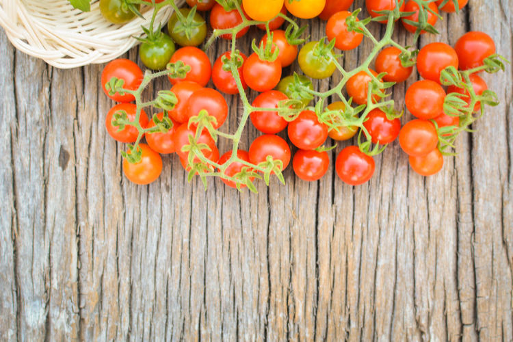 Close-up of cherry tomatoes on wooden table
