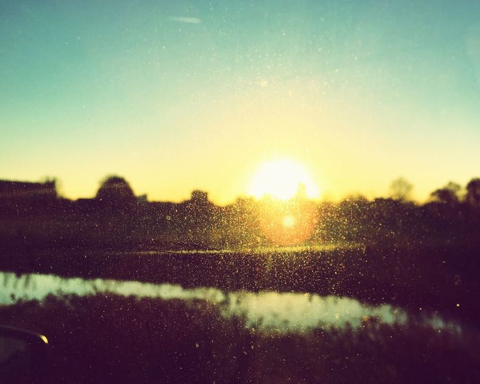 Sunset Nature Water Sun Sunlight No People Wet Drop Sky Close-up Outdoors Beauty In Nature Day Beauty In Nature Sunlight Sunset_collection Car Mirror Netherlands Nederland Industry Winter EyeEm Nature Lover Orange Color Red