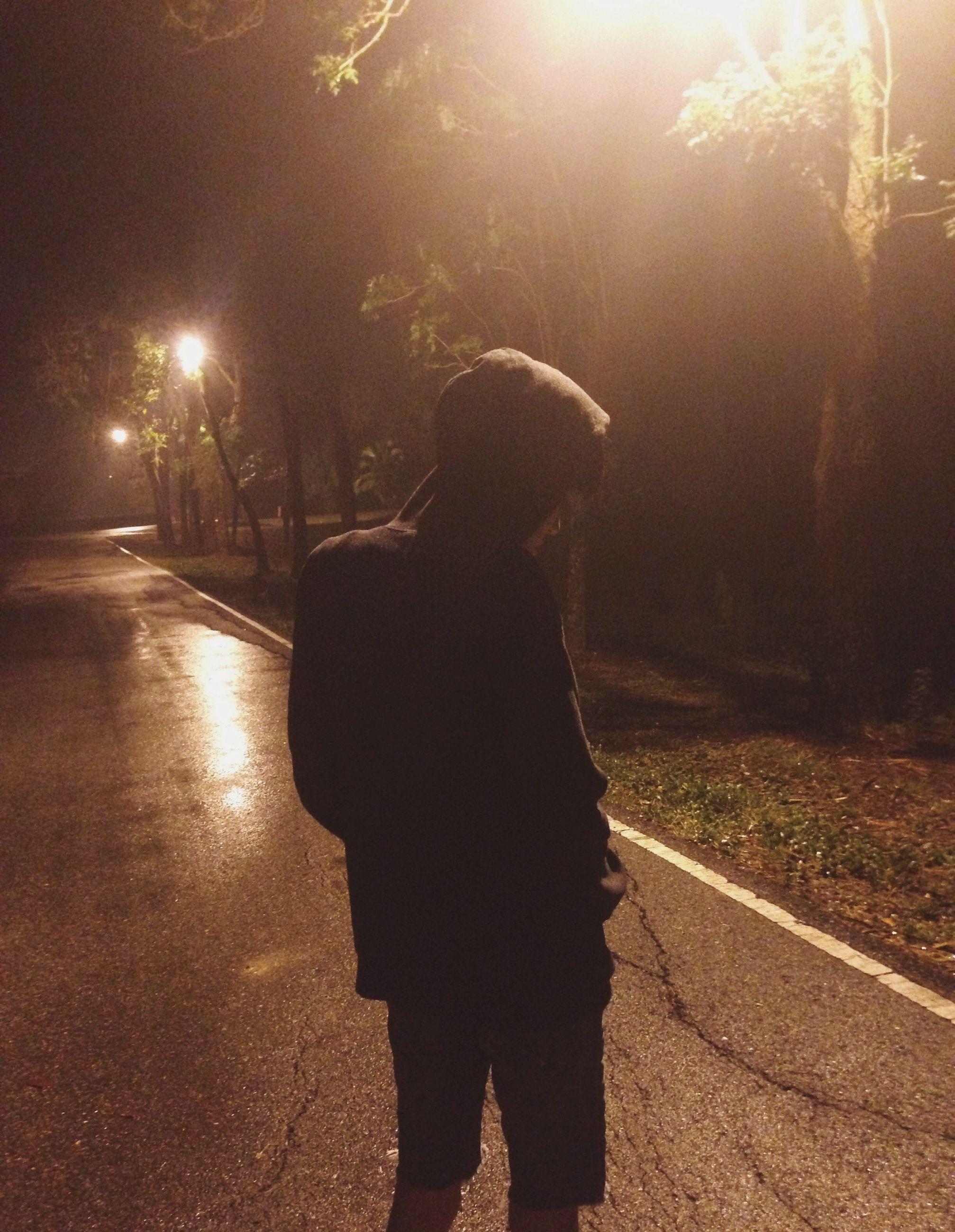night, lifestyles, rear view, illuminated, full length, leisure activity, street, silhouette, road, standing, person, walking, men, outdoors, street light, motion, sunlight, lens flare