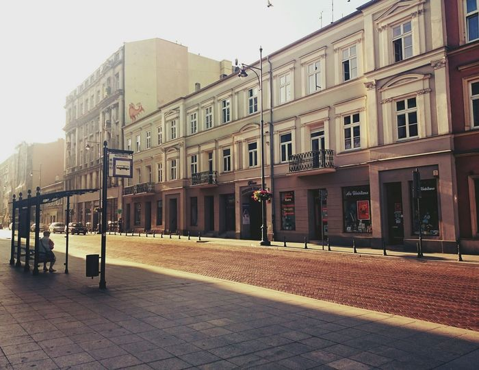 Streetphotography Tram Stop Waiting For A Train Tenements Sunlight Architecture_collection Peaceful Moment Peaceful Morning Everyday Life Alone In The City  Piotrkowskastreet Łódź, Poland Showcase July