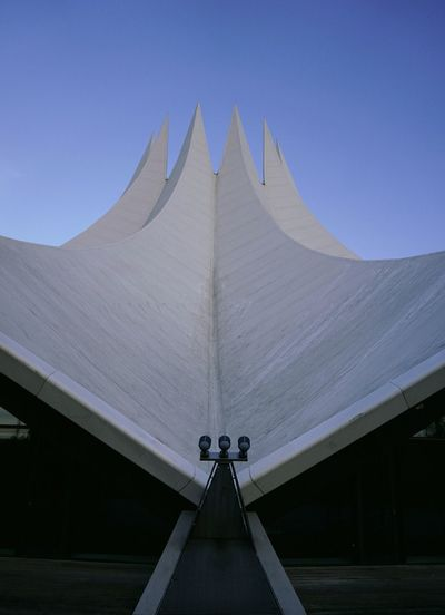 Low angle view of tempodrom berlin against clear blue sky