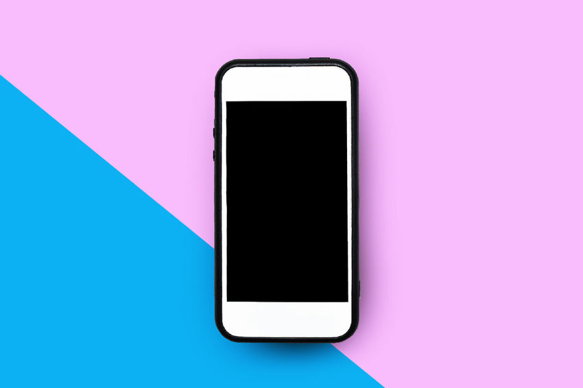 white smartphone on colorful background EyeEm EyeEm Selects Black Color Blank Colored Background Communication Computer Monitor Connection Copy Space Device Screen Global Communications Indoors  Mobile Phone No People Pink Color Portable Information Device Screen Smart Phone Smartphone Studio Shot Technology Telecommunications Equipment Touch Screen White Smartphones Wireless Technology The Creative - 2018 EyeEm Awards