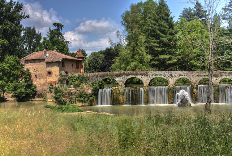 water mill of Theoule Cordes-Tolosannes France Architecture Beauty In Nature Building Exterior Built Structure Cloud - Sky Day Grass Growth Nature No People Outdoors Sky Tree Water Water Mill