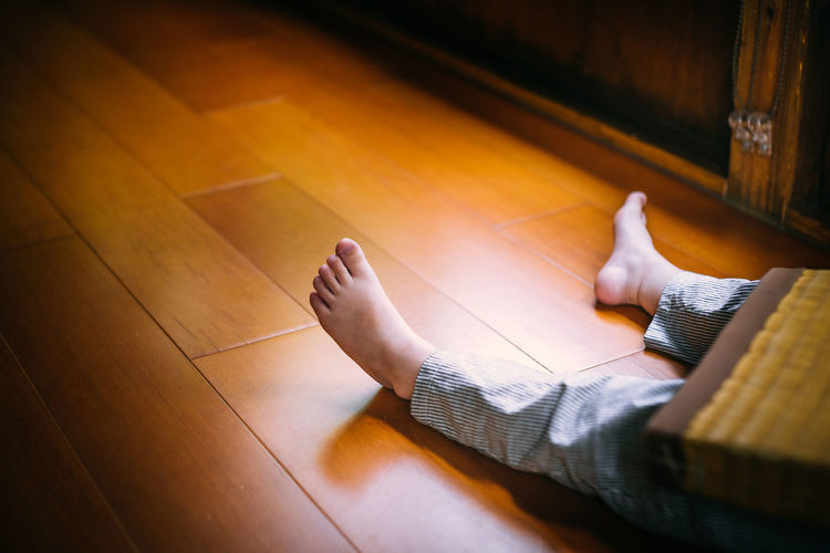 High angle view of child on floor at home