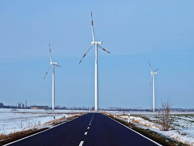 Alternative energy on the road / alternative energie an der straße Alternative Energy Architecture Bluesky Cold Temperature Day Energy Landscape Nature No People On The Road Outdoors Road Sky Snow Snow ❄ Street Verkehr Wind Turbine Wind Turbine Tower Wind Turbines Field Windräder Winter