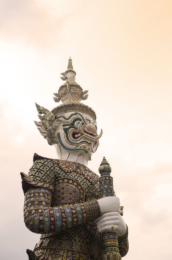 Architectural Feature Big Statue Cloud - Sky Giant Statue High Section History In Wat Phra Keaw Landmark Majestic No People Sky Spire  Temple Wat Phra Keaw Travel Destinations Outdoors Statue Bangkok Thailand.