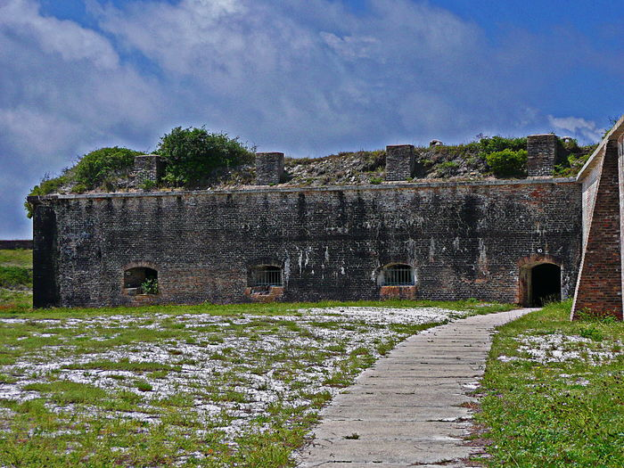 View of an area within Fort Pickens Ancient Architecture Blue Built Structure Cloud Cloud - Sky Day Fort Pickens Grass Green Color Growth History Landscape Nature No People Old Outdoors Pensacola Beach Plant Sky The Past Town Travel Destinations