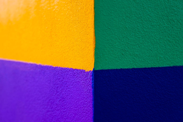 Abstract geometric pattern on concrete wall Art And Craft Art And Craft Equipment Backgrounds Blue Choice Close-up Copy Space Creativity Design Directly Above Full Frame High Angle View Indoors  Multi Colored No People Orange Color Pattern Purple Still Life Textile Textured  Variation