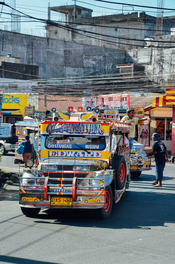 Transportation City Mode Of Transportation Street Architecture Road Land Vehicle City Life Car Motor Vehicle Occupation City Street Outdoors The Philippines Jeepneys Jeeps Public Transportation Lively Busy Street Colourful Bus Local Bus Ubiquitous Manila Journey
