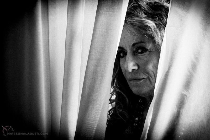 You could never tell what she was thinking, but her deep eyes could read into your soul... Black And White Stories Portrait Of A Woman Black And White Portrait Black And White Photography