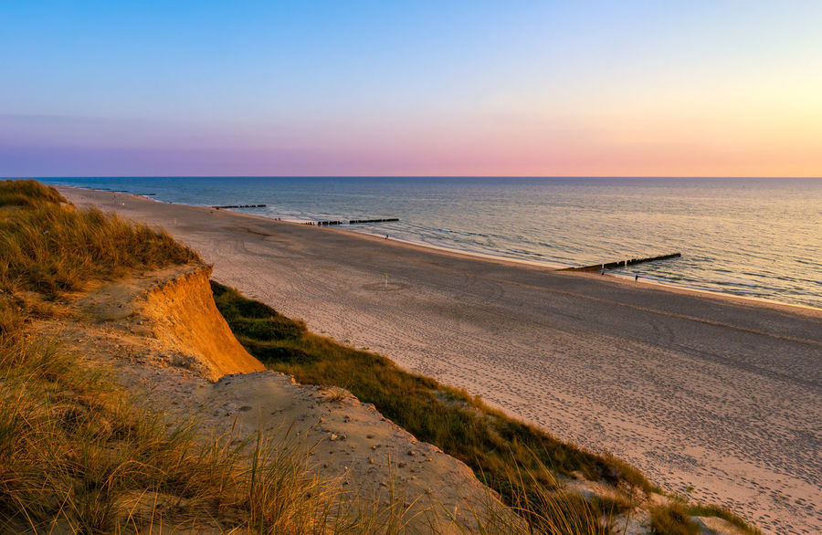 Red Cliff - Sylt Deutschland Kampen, Sylt Rotes Kliff, Kampen Rotes Kliff, Sylt Sylt, Germany Beach Beauty In Nature Clear Sky Horizon Horizon Over Water No People North Sea Outdoors Red Cliff Scenics - Nature Sea Sky Sunset Sunsets Sylt Tranquility Travel Destinations Water