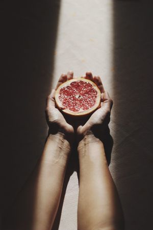 Food Healthy Eating Food And Drink Fruit Freshness One Person Cross Section Indoors  Ready-to-eat Person Human Body Part Day Pomegranate Holding SLICE Red Blood Orange Eye4photography  Close-up Food And Drink Freshness