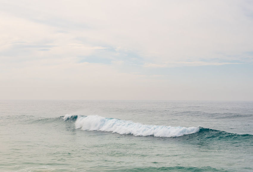 Ocean and blue sky on hazy autumn day Aquatic Sport Beauty In Nature Cloud - Sky Day Horizon Horizon Over Water Idyllic Motion Nature Outdoors Power In Nature Scenics - Nature Sea Sky Sport Surfing Water Waterfront Wave
