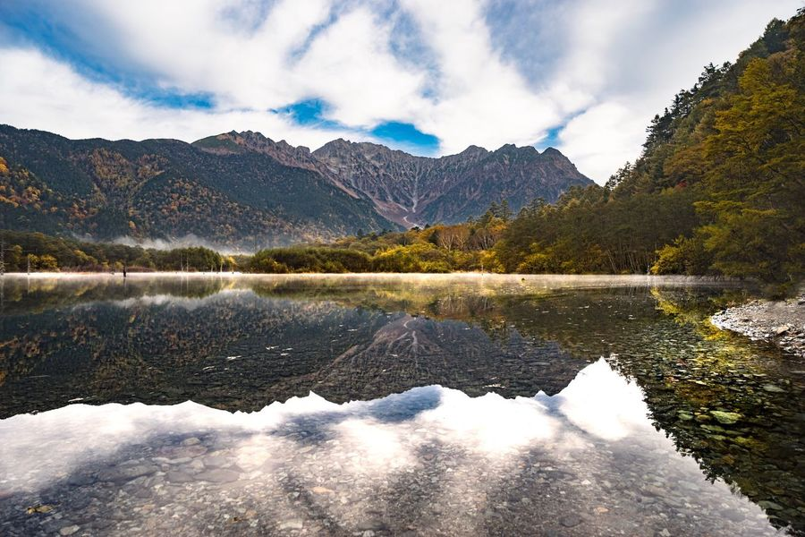 My Year My View Kamikochi Reflection Lake Beauty In Nature Nature Water Scenics Sky Tranquil Scene Mountain Idyllic No People Mountain Range Outdoors Tranquility Tree Landscape Day Autumn Travel Destinations Tranquility Landmark Resort at Taishoike Lakeside in Matsumoto,Japan