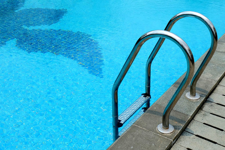 Absence Bannister Blue Blue Water Blue Wave Clean Clear Water Day Empty Geometric Shape Handrail  Man Made Object Metal No People Outdoors Poolside Single Object Summer Swimming Pool Swimming Time Swimmingpool Tranquility Vacations Water Water Reflections