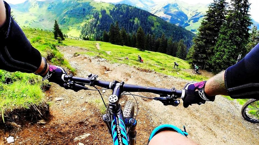 Bicycle Sunlight Green Color Outdoors Real People Lifestyles Day Sport Tree Adult Outdoors Photograpghy  Mountain Downhill Racer Extreme Sports