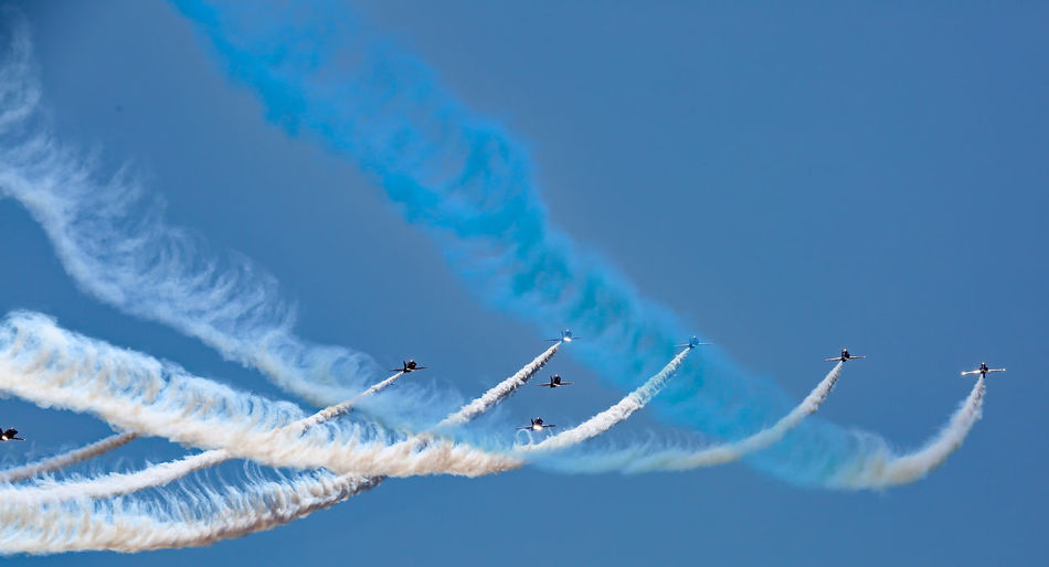 Aerobatics Air Vehicle Airplane Airshow Blue Flying Formation Flying Performance Sky Speed Stunt Vapor Trail