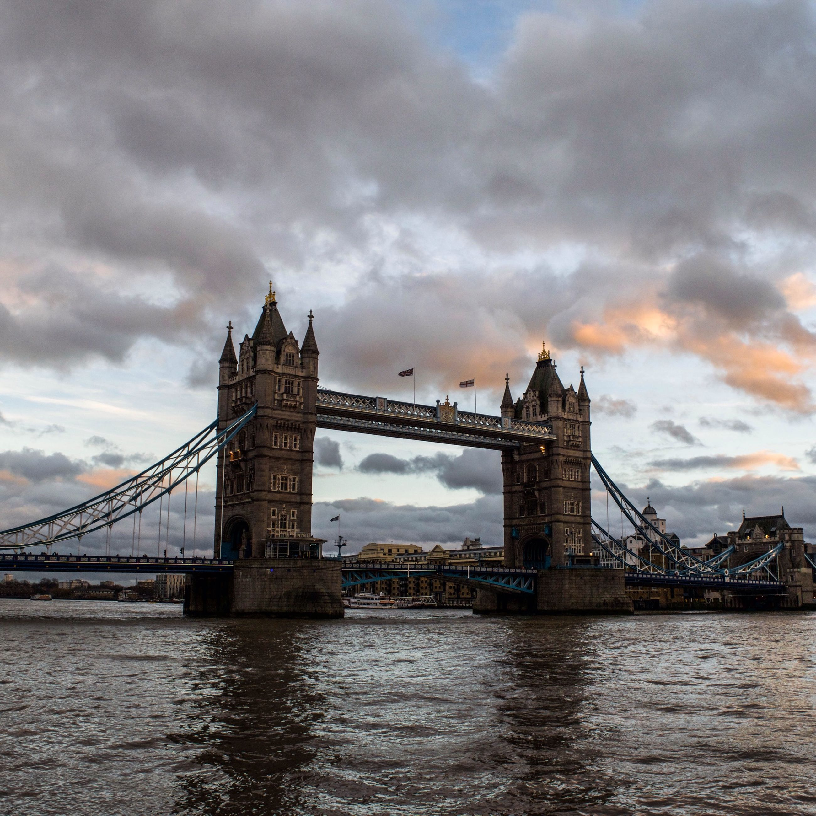 architecture, built structure, connection, bridge - man made structure, sky, water, waterfront, cloud - sky, river, engineering, famous place, international landmark, travel destinations, cloudy, transportation, thames river, suspension bridge, bridge, cloud, travel