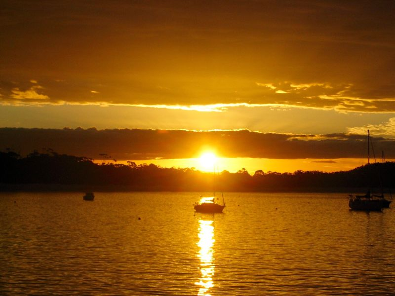 Sunset Sun Water Boat Waterfront Orange Tranquil Scene Sky Tranquility Reflection Nature Cloud Sunbeam Ocean Canonphotography The Great Outdoors - 2016 EyeEm Awards Port Stephens Australia Feel The Journey