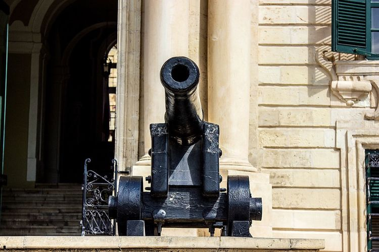 Close-Up Of Cannon By Building