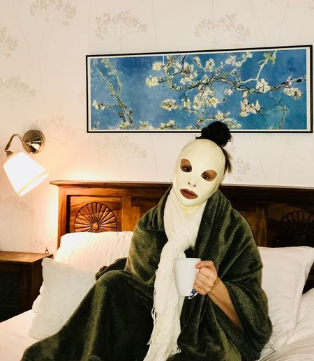 Portrait of person wearing mask at home