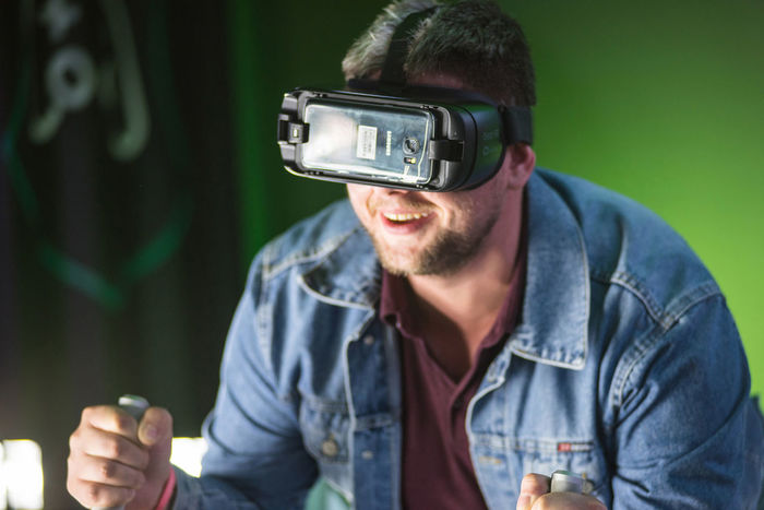 BONTIDA, ROMANIA - JULY 14, 2017: A guy using Samsung virtual reality headset. Man playing with a VR oculus googles at Electric Castle festival tech zone 3D Futuristic Gaming Oculus Samsung Simulator Virtual Virtual Reality Simulator Virtual Reality VirtualReality Cyber Experience Google Guy Headset Man People Person Simulation Technology Virtual Reality Headset Virtual Reality World Vision Visual Vr