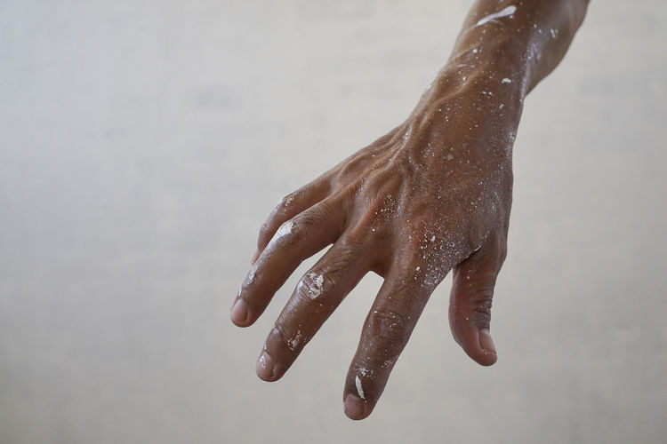Close-up of hand on wet floor