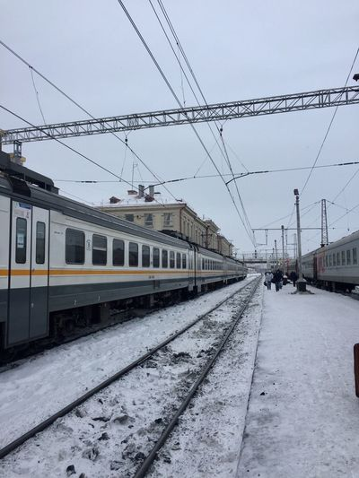 Railroad Track Transportation Cable Rail Transportation Sky Outdoors Public Transportation Power Line  Winter Snow Train - Vehicle Railroad Station Building Exterior Cold Temperature No People Railroad Station Platform Day