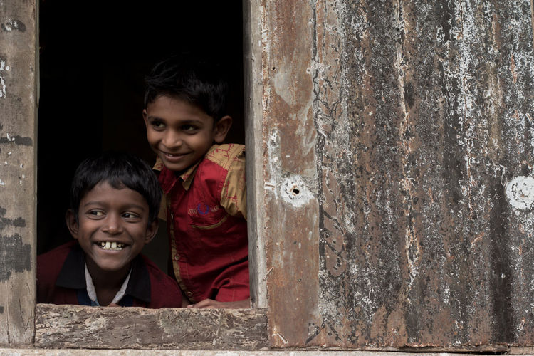 Behappy Candid Childhood Dark Diversity Friends Happiness Incredible India Joy Kids Peeking Out People Smile Street Tamil Tamilnadu The Week On EyeEm Window
