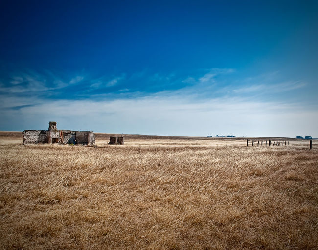 The Homestead Ruins Grassland Farm Landscape Old House Abandoned Buildings Blue Sky Blue And Gold Blue And Brown Straw Hay Farm Life Farming Life Blue Heat - Temperature Agriculture Sky Landscape Cloud - Sky Drought Barren Arid Landscape Dry Arid