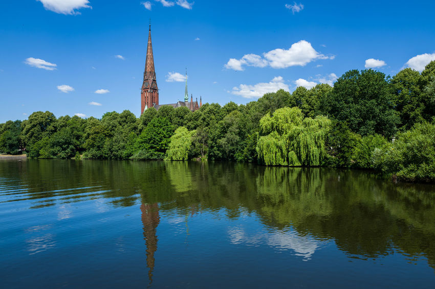 Hamburg Alster Architecture Beauty In Nature Building Exterior Built Structure Cloud - Sky Day Green Color Growth Lake Nature No People Outdoors Plant Reflection Scenics - Nature Sky Spire  Tranquility Tree Water Waterfront