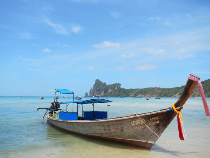 Longtail boat on shore at phi phi islands