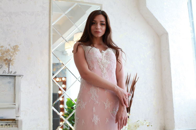 Pink Color Pink Dress Water Wedding Dress Bride White Background Standing One Person Young Women Young Adult Beautiful Woman Real People Clothing Beauty Three Quarter Length Lifestyles Portrait Women Looking At Camera Leisure Activity Window Architecture Day Fashion Contemplation Outdoors
