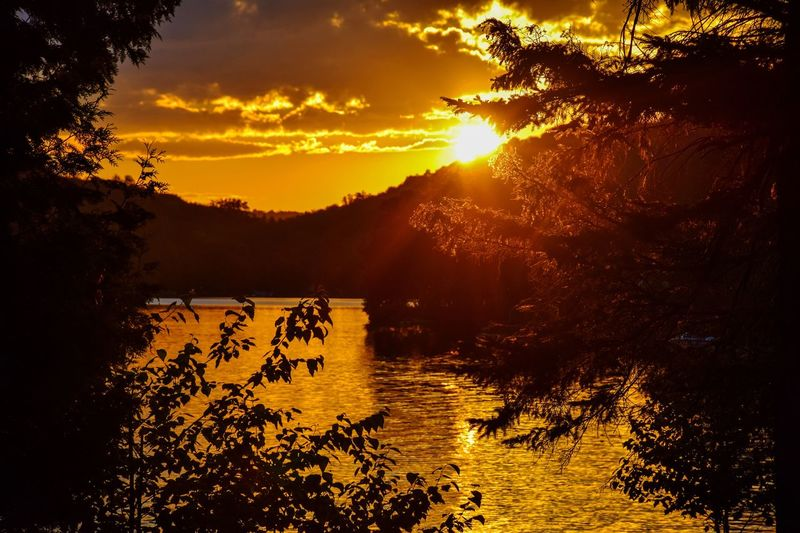 Sunset Reflection Landscape Water Nature Tranquility Outdoors Sunlight Lake Tree Scenics Gold Colored No People Beauty In Nature Dawn Sky Mountain Shadows Peaking Through EyeEmNewHere