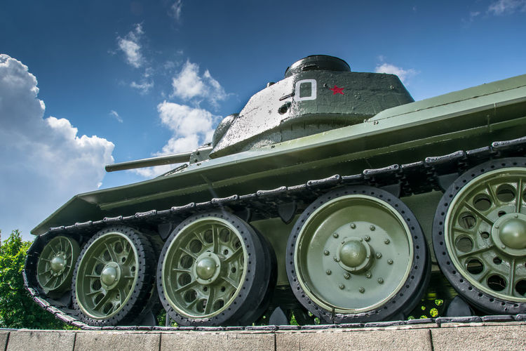Low Angle View Of Armored Tank Against Sky