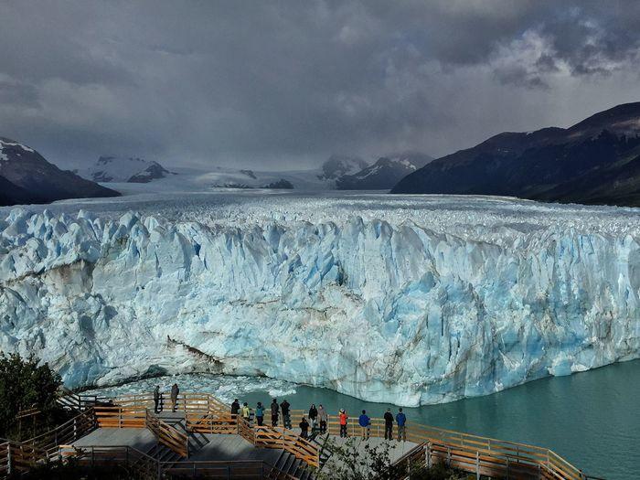 Scenic View Of Moreno Glacier Against Cloudy Sky