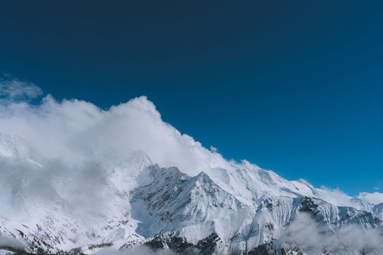 Find more travel inspiration at http://www.instagram.com/simonmigaj Chamonix-Mont-Blanc Travel Alps Beauty In Nature Blue Cloud - Sky Cold Temperature Day Environment Idyllic Landscape Mountain Mountain Peak Mountain Range Nature No People Scenics - Nature Sky Snow Snowcapped Mountain Tranquil Scene Tranquility Winter