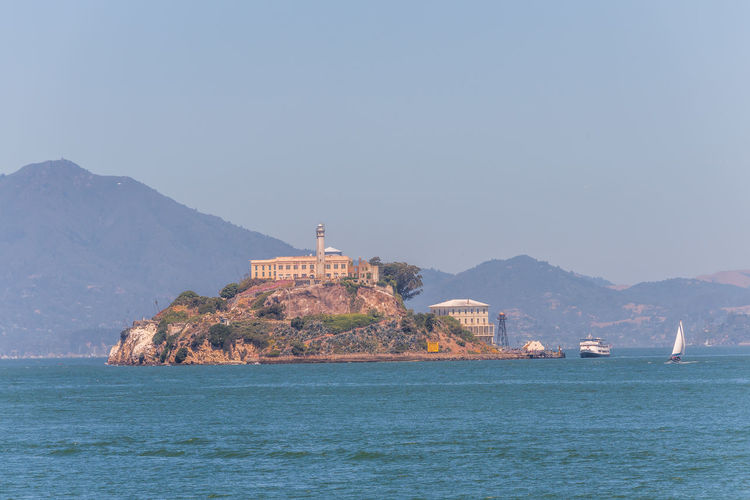 Alcatraz Prison Mountain Water Sea Sky Waterfront Scenics - Nature Architecture Beauty In Nature Built Structure Nature Clear Sky Building Exterior Copy Space No People Tranquil Scene Building Day Tranquility Land Mountain Range Outdoors