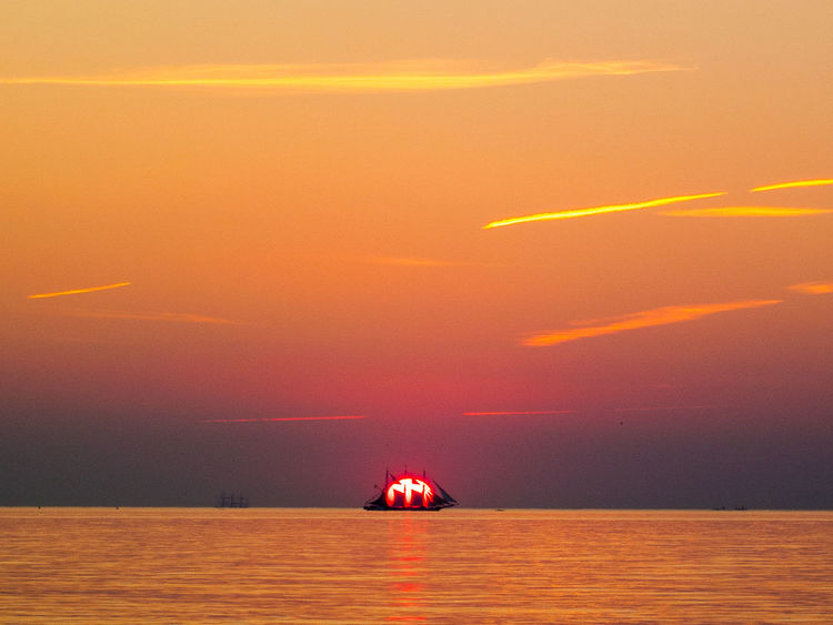 Beauty In Nature Day Horizon Over Water Nature No People Outdoors Red Scenery Scenics Sea Sky Sun Sunlight Sunset Tranquil Scene Tranquility Water Waterfront
