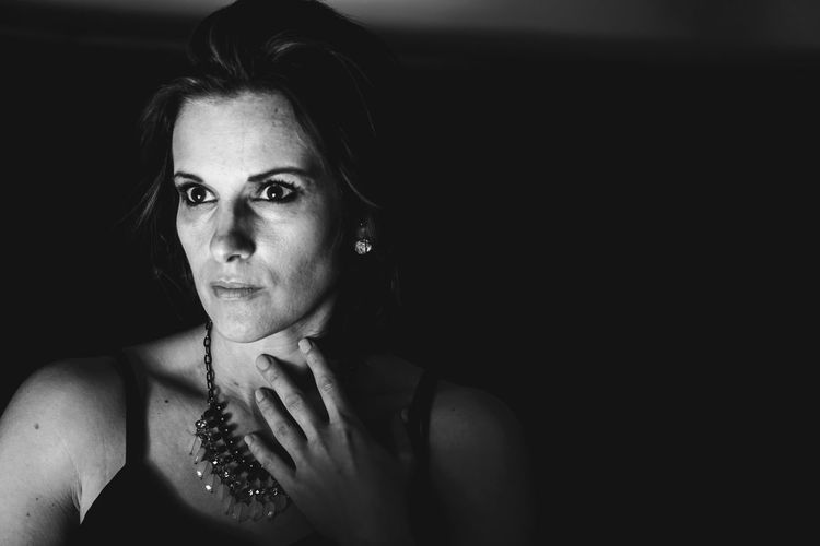 EyeEm Selects Only Women Serious Adults Only One Woman Only Adult Portrait One Person Black Background Blank Expression