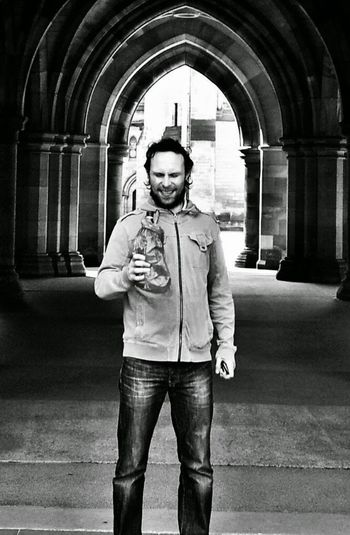 Buckfast Glasgow University Blackandwhite Brown Paper Bag Gothic Arch Daytime Drinking Portrait Of A Man