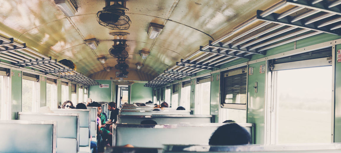 Indoors  Ceiling Group Of People Lighting Equipment Real People Men Architecture Transportation Women Public Transportation Large Group Of People Day Seat Crowd Illuminated Adult Sitting Mode Of Transportation Built Structure Train Travel Vehicle Passenger Tram Tramcar