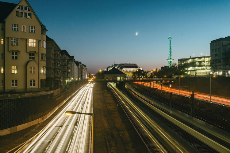 Berlin, Germany, October 13, 2018: Highway with Traffic and ICC and Funkturm After Sunset Berlin Germany 🇩🇪 Deutschland Horizontal Color Image Outdoors No People Architecture Built Structure Building Exterior Illuminated Light Trail Railroad Track Dusk High Angle View Highway Sunset Red White Color Tail Light Headlight Funkturm Blurred Motion Radio Tower ICC International Congress Center